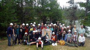 Dryden conservation camp participants pose near lake
