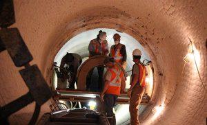 workmen in a tunnel