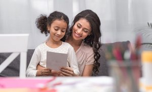Mother and daughter looking at a card together