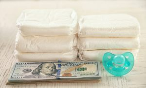 Stacked diapers, stacked cash, and a pascifier