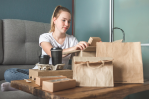 Woman with paper packaging. Paper Packaging Answers Demand for Plastic Alternatives